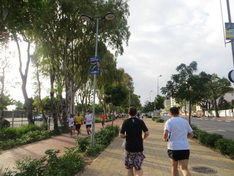 Runners participati gin the timed 5km Green Point parkrun